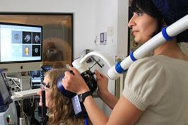Demonstrating use of scanning equipment